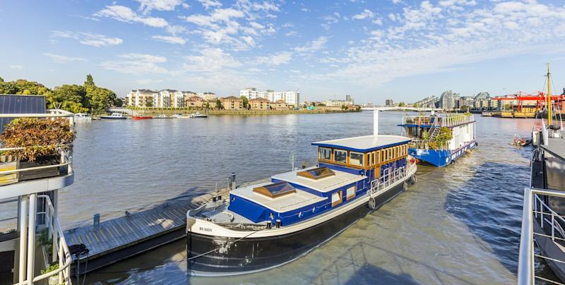 This modern houseboat for sale in Wandsworth is a luxurious floating home