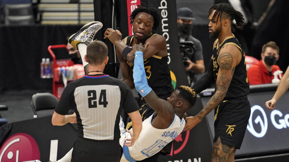 Toronto Raptors forward OG Anunoby (3) throws Los Angeles Lakers guard Dennis Schroder (17) to the floor after a foul during the first half of an NBA basketball game Tuesday, April 6, 2021, in Tampa, Fla. Both players were ejected after a brief scuffle. Looking on is guard Gary Trent Jr. (33) (AP Photo/Chris O'Meara)