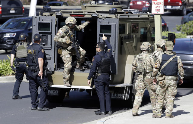 <p>Armed law enforcement personnel exit an armored vehicle outside YouTube headquarters, Tuesday, April 3, 2018, in San Bruno, Calif. A woman opened fire at YouTube headquarters Tuesday, setting off a panic among employees and wounding several people before fatally shooting herself, police and witnesses said. (Photo: Marcio Jose Sanchez/AP) </p>