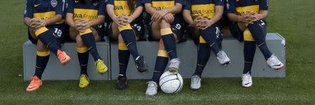 Players from Boca Juniors women's soccer club pose for a photo session in Buenos Aires October 4, 2013. REUTERS/Carolina Camps