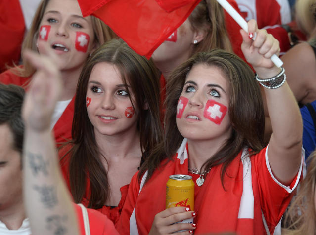 Soccer fans watch the live broadcast from Brazil of the World Cup match between Switzerland and France at the public viewing WM-Lounge Europaallee in Zurich, Switzerland, Friday, June 20, 2014. (AP Photo / KEYSTONE/Steffen Schmidt)