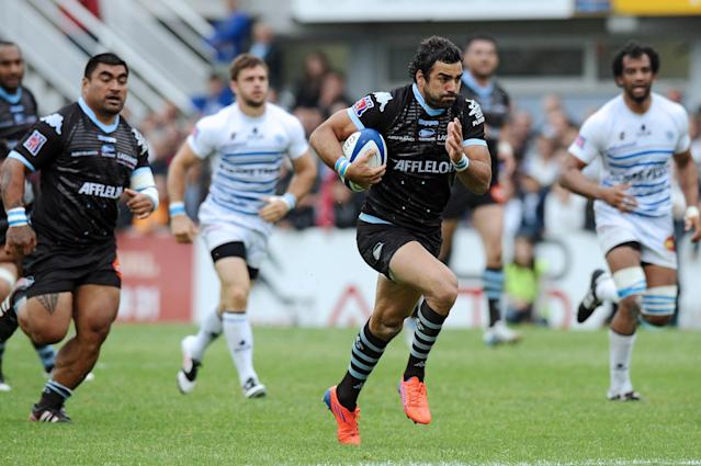 Bayonne's fullback Yoann Huget runs for scores a try during the French top 14 rugby union match Castres vs Bayonne on May 12, 2012 at the Pierre Antoine stadium in the French southern city of Castres. AFP PHOTO / REMY GABALDAREMY GABALDA/AFP/GettyImages