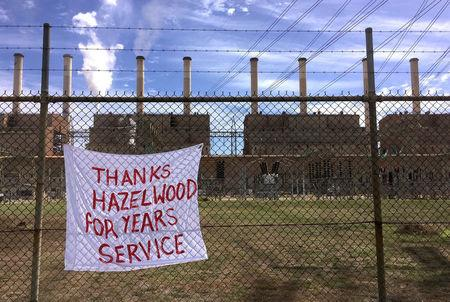 A sign adorns the fence surrounding the Hazelwood Power Station before its closure on March 31 in the town of Hazelwood, located in the Latrobe Valley, south-east of Melbourne in Australia