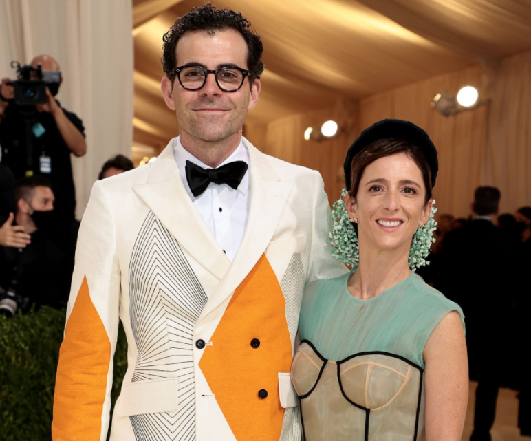 A close up ofAdam and Monica Mosseri as they pose on the Met Gala carpet