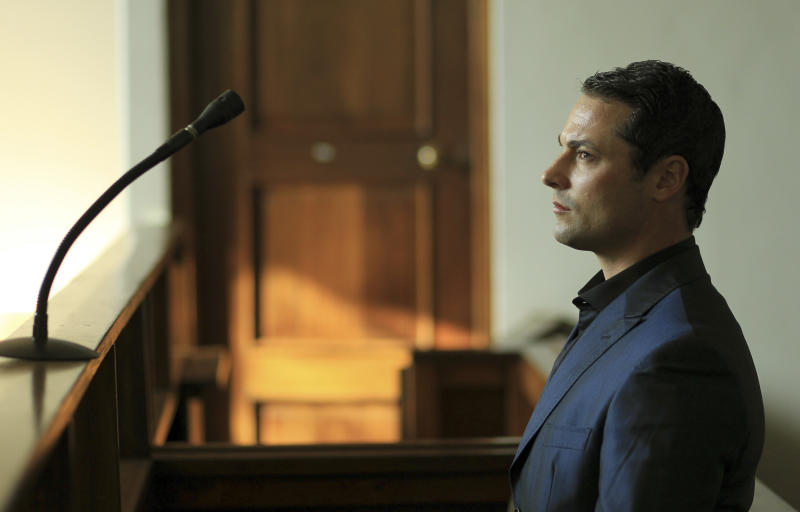 Carl Pistorius, brother of Oscar Pistorius, the superstar double-amputee Olympic athlete who shot and killed his girlfriend and is accused of murder, stands inside the court for his culpable homicide case at the Magistrate Court in Vanderbijlpark, South Africa on Tuesday, May 21, 2013.(AP Photo/Themba Hadebe)