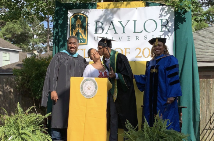 Derrick Williams kisses his mom, Ayanna Tatum, after she threw him a surprise graduation in their backyard. (Photo: Courtesy of Ayanna Tatum)
