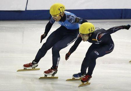 Viktor Ahn (L) of Russia and Da Woon Sin of South Korea compete in the men's 1500m final race during the ISU Short Track World Cup speed skating competition in Shanghai December 8, 2012. REUTERS/Carlos Barria