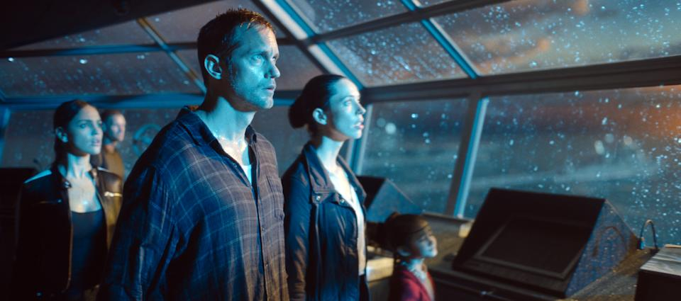 Alexander Skarsgård and Rebecca Hall stare in shock at the arrival of Godzilla