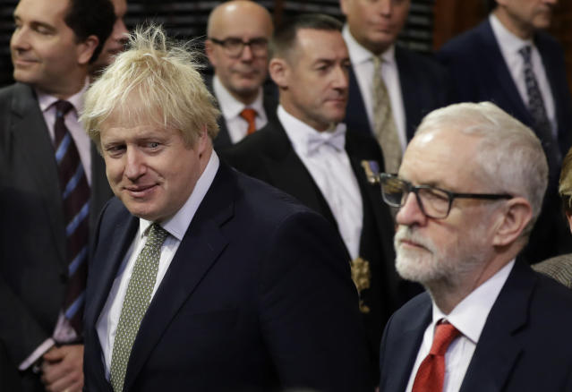 Boris Johnson and Jeremy Corbyn walk through the Commons during the state opening of Parliament one week after the election. (AP Photo/Kirsty Wigglesworth)