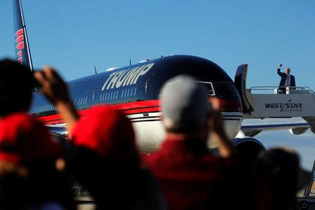 Trump arrives on his plane for a campaign rally in Grand Junction, Colorado