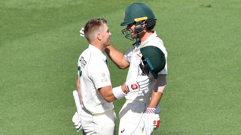 David Warner (L) and Joe Burns (R) have put Australia in command of the first Test against Pakistan