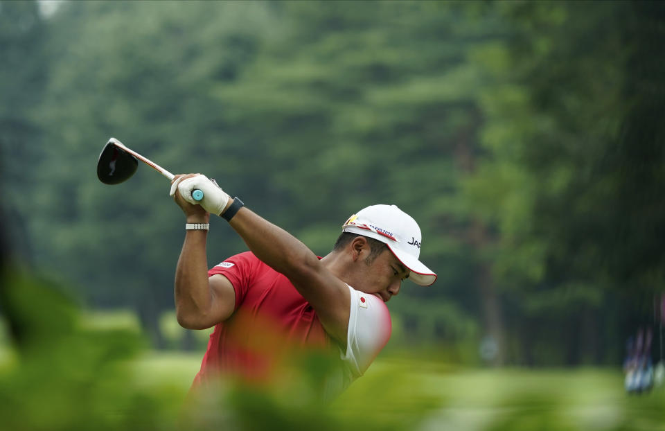 Japan's Hideki Matsuyama hits a tee shot on the 13th hole during the first round of the men's golf event at the 2020 Summer Olympics on Wednesday, July 28, 2021, at the Kasumigaseki Country Club in Kawagoe, Japan. (AP Photo/Matt York)