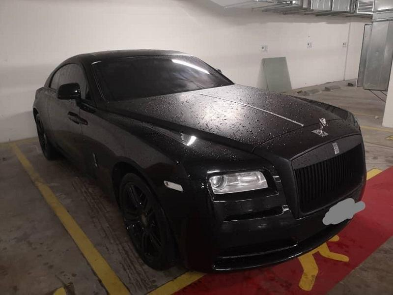 MACC investigators confiscated a Rolls-Royce limousine, a Ford Mustang, a Range Rover and an Audi during a crackdown on a people-smuggling syndicate November 20, 2020. — Picture from social media