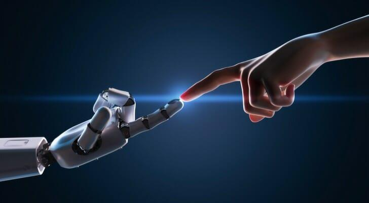Human and robot touch fingers