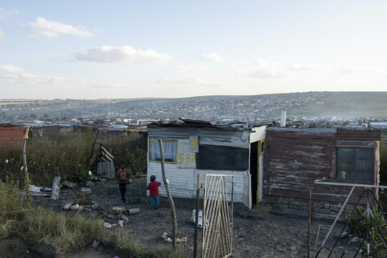 People in the townships live in makeshift shacks where coal is the only source of energy