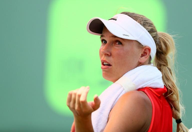 Caroline Wozniacki of Denmark looks on between games against Johanna Konta of Great Britain during the Women's Final on Day 13 of the Miami Open at Crandon Park Tennis Center on April 1, 2017 in Key Biscayne, Florida