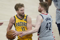 Indiana Pacers' Domantas Sabonis (11) is fouled by Washington Wizards' Davis Bertans (42) as he goes up for a shot during the second half of an NBA basketball game, Saturday, May 8, 2021, in Indianapolis. (AP Photo/Darron Cummings)