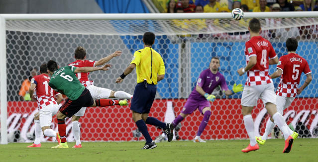 A shot by Mexico's Hector Herrera hit the bar of the Croatian side during the group A World Cup soccer match between Croatia and Mexico at the Arena Pernambuco in Recife, Brazil, Monday, June 23, 2014. (AP Photo/Ricardo Mazalan)