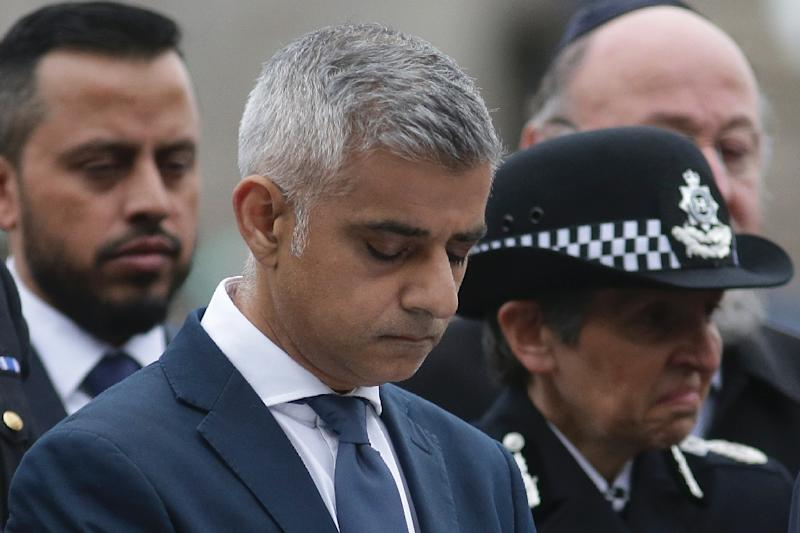 London Mayor Sadiq Khan bows his head during a vigil in Potters Fields Park in London on June 5, 2017