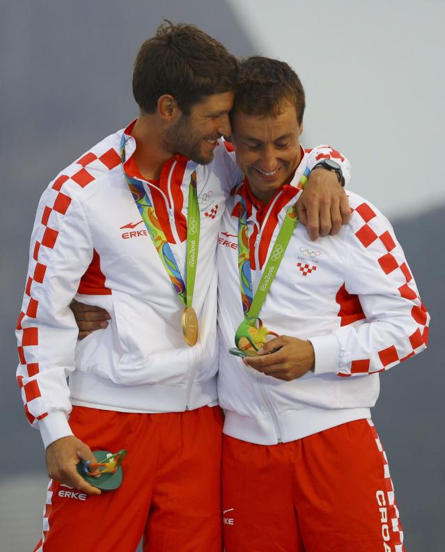 2016 Rio Olympics - Sailing - Victory Ceremony - Men's Two Person Dinghy - 470 - Victory Ceremony - Marina de Gloria - Rio de Janeiro, Brazil - 17/08/2016. Sime Fantela (CRO) of Croatia and Igor Marenic (CRO) of Croatia celebrate gold medal. REUTERS/Brian Snyder FOR EDITORIAL USE ONLY. NOT FOR SALE FOR MARKETING OR ADVERTISING CAMPAIGNS.