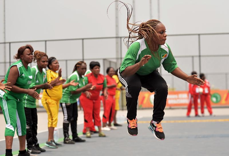 Congolese athletes compete in the game of Nzango at the 11th African Games in Brazzaville (AFP Photo/Monirul Bhuiyan)