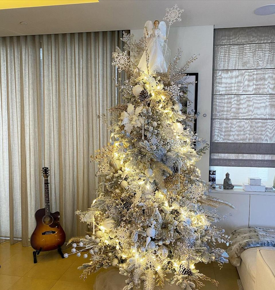 Delta Goodrem's Christmas tree was topped with a white angel