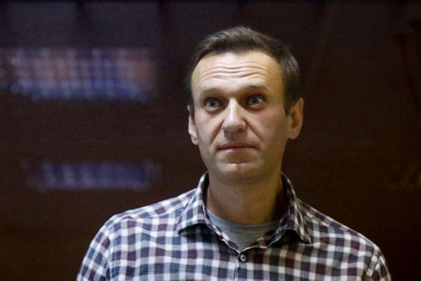 PHOTO: Russian opposition leader Alexei Navalny stands in a cage in the Babuskinsky District Court in Moscow, Feb. 20, 2021.  (Alexander Zemlianichenko/AP, FILE)