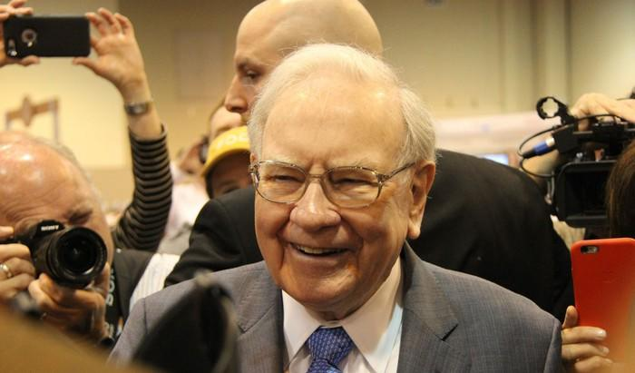A picture of smiling Warren Buffett.