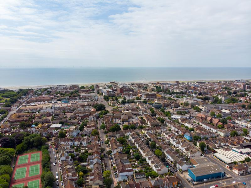 Aerial photo of the town of Worthing, large seaside town in England, and district with borough status in West Sussex, England UK, showing typical housing estates and businesses on a bright sunny day