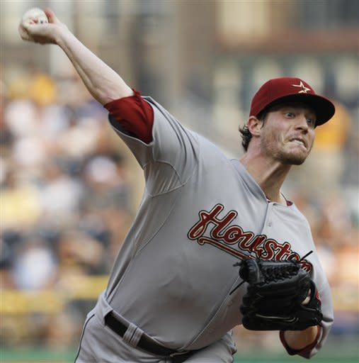 Houston Astros starting pitcher Lucas Harrell throws against the Pittsburgh Pirates in the second inning of the baseball game on Tuesday, July 3, 2012, in Pittsburgh. (AP Photo/Keith Srakocic)