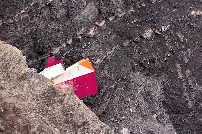 A screen grab taken on March 24, 2015 shows part of the vertical stabilizer of the Germanwings Airbus A320 at the crash site in the French Alps, above the southeastern town of Seyne (AFP Photo/Denis Bois)