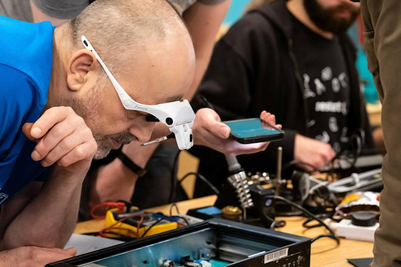 Industry experts volunteer their time to show the public how to fix their electronics, seen here at a Brixton workshop (Mark Phillips)