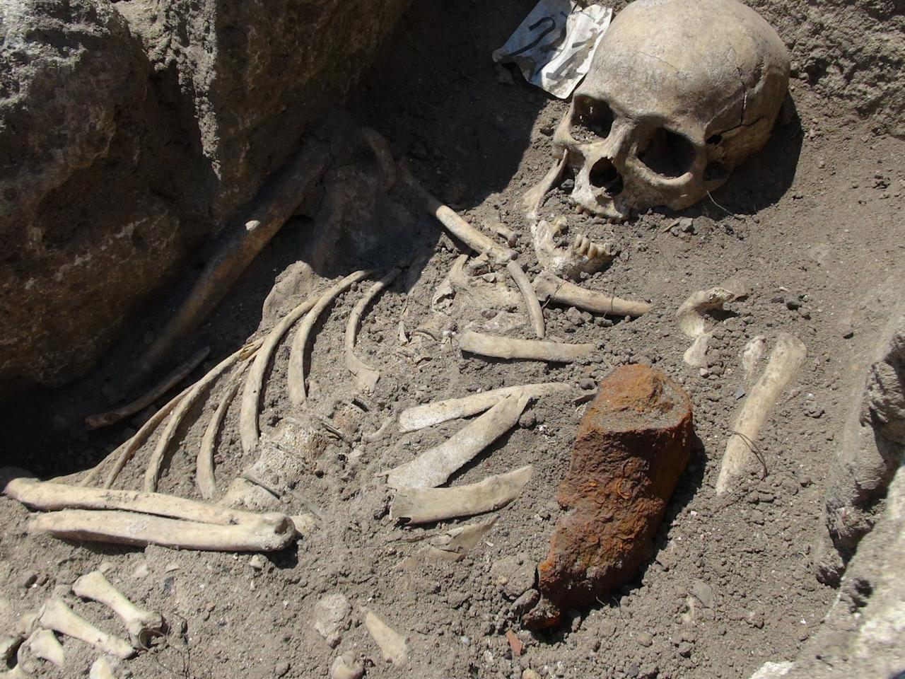 In this Sunday, June 3, 2012 photo showing a piece of iron next to skeleton dated back in the Middle Ages, at the archeological site in the Black sea town of Sozopol. Bulgarian archaeologists say they have unearthed centuries-old skeletons pinned down through their chests with iron rods - a practice believed to stop the dead from becoming vampires. (AP Photo)