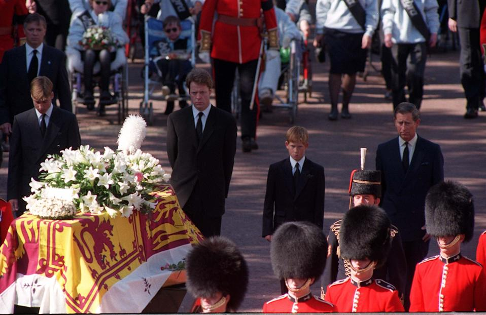 Prince Harry walks behind the coffin of his mother in 1997PA Archive