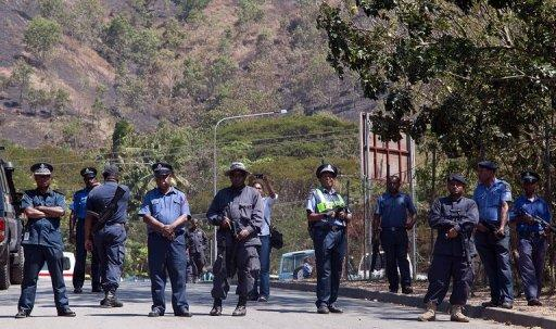 Papua New Guinea police officers in Port Moresby on August 2, 2013