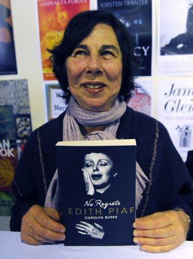 Australian-born writer Carolyn Burke displays her new book 'No Regrets: Edith Piaf' at the Sydney Writers' Festival. The book reveals much about Piaf's life before stardom, including her yearnings for poetry and philosophy as a young girl working to overcome her tough upbringing