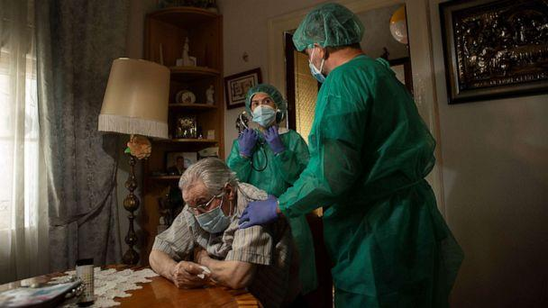 PHOTO: Medical personnel care for a patient during a house call visit in Barcelona, Spain, May 23, 2020. These home services during the Covid-19 pandemic provide tests and care to people with low mobility or on isolation. (Enric Fontcuberta/EPA via Shutterstock, FILE)