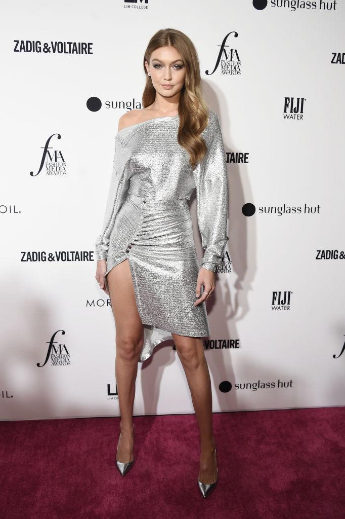 <p>Model Gigi Hadid gave us party season inspo in an off-the-shoulder metallic dress and co-ordinating shoes. <em>[Photo: Getty]</em> </p>