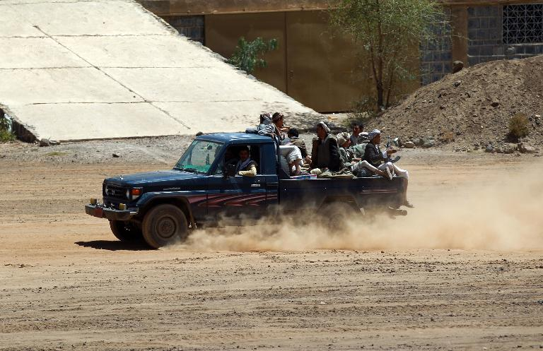 Yemeni Shiite rebels drive a pickup truck at an army base which they captured on September 22, 2014 in the capital, Sanaa