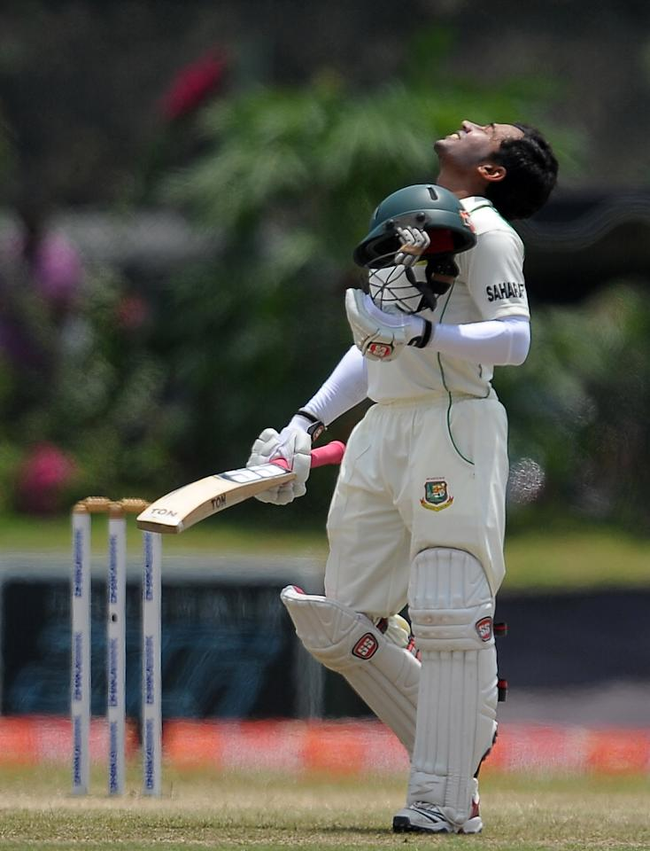 Bangladeshi captain Mushfiqur Rahim reacts after scoring a double century (200 runs) during the fourth day of the opening Test match between Sri Lanka and Bangladesh at the Galle International Cricket Stadium in Galle on March 11, 2013. AFP PHOTO/ LAKRUWAN WANNIARACHCHI        (Photo credit should read LAKRUWAN WANNIARACHCHI/AFP/Getty Images)