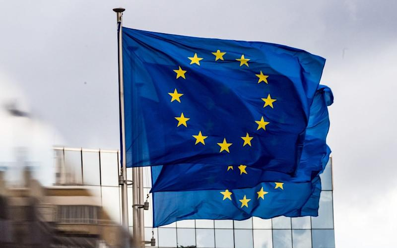 Three European Union (EU) flags fly outside the Berlaymont building, headquarters of the European Commission - Bloomberg