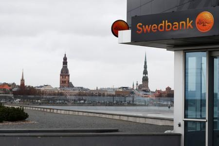 Swedbank signs are seen on the bank's Latvian head office in Riga