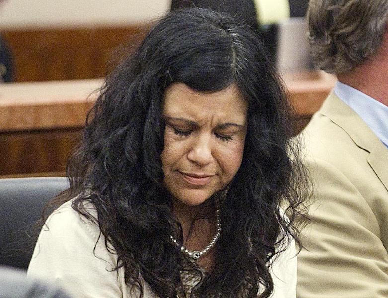 FILE - In this April 8, 2014, file photo, Ana Trujillo reacts after being found guilty of killing her boyfriend in Houston. Trujillo, 45, was found guilty of fatally stabbing her boyfriend with the stiletto heel of her shoe, hitting him at least 25 times in the face. Jurors have begun deliberating her sentence. (AP Photo/Houston Chronicle, Brett Coomer, File)