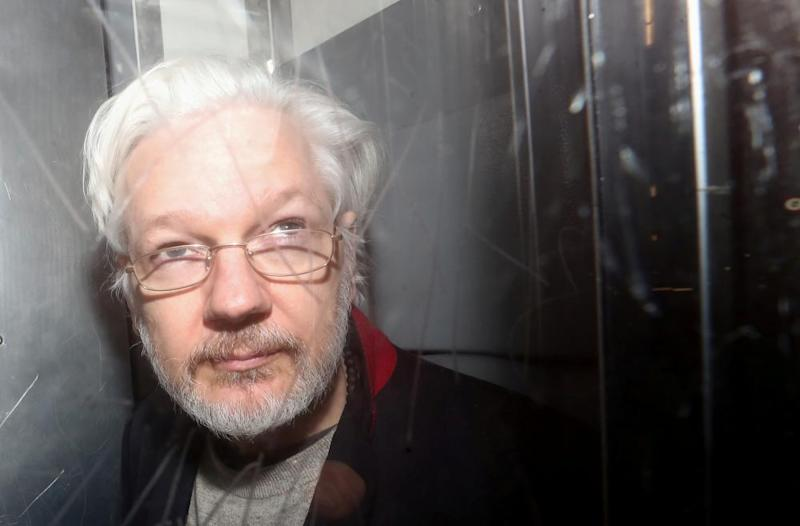 Julian Assange leaves Westminster magistrates court in London after a hearing last month.