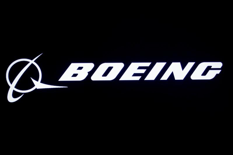 The Boeing logo is displayed on a screen, at the NYSE in New York