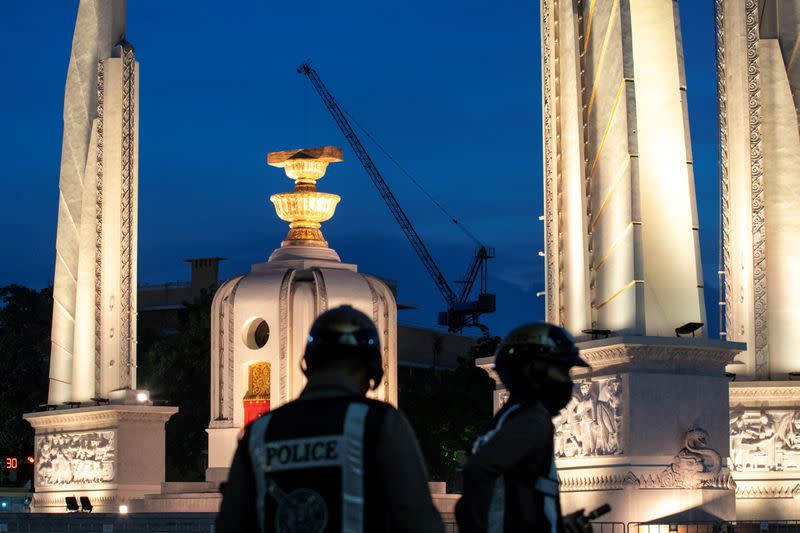 Police officers are seen next to the Democracy monument in Bangkok