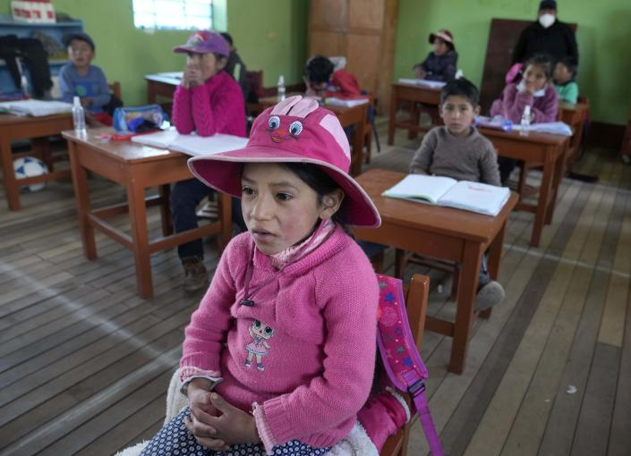 Students attend Quechua Indigenous language class at a public primary school in Licapa, Peru, Wednesday, Sept. 1, 2021. The school began to teach Quechua for the first time in April, when bilingual teacher Alicia Cisneros was transferred to the village. (AP Photo/Martin Mejia)