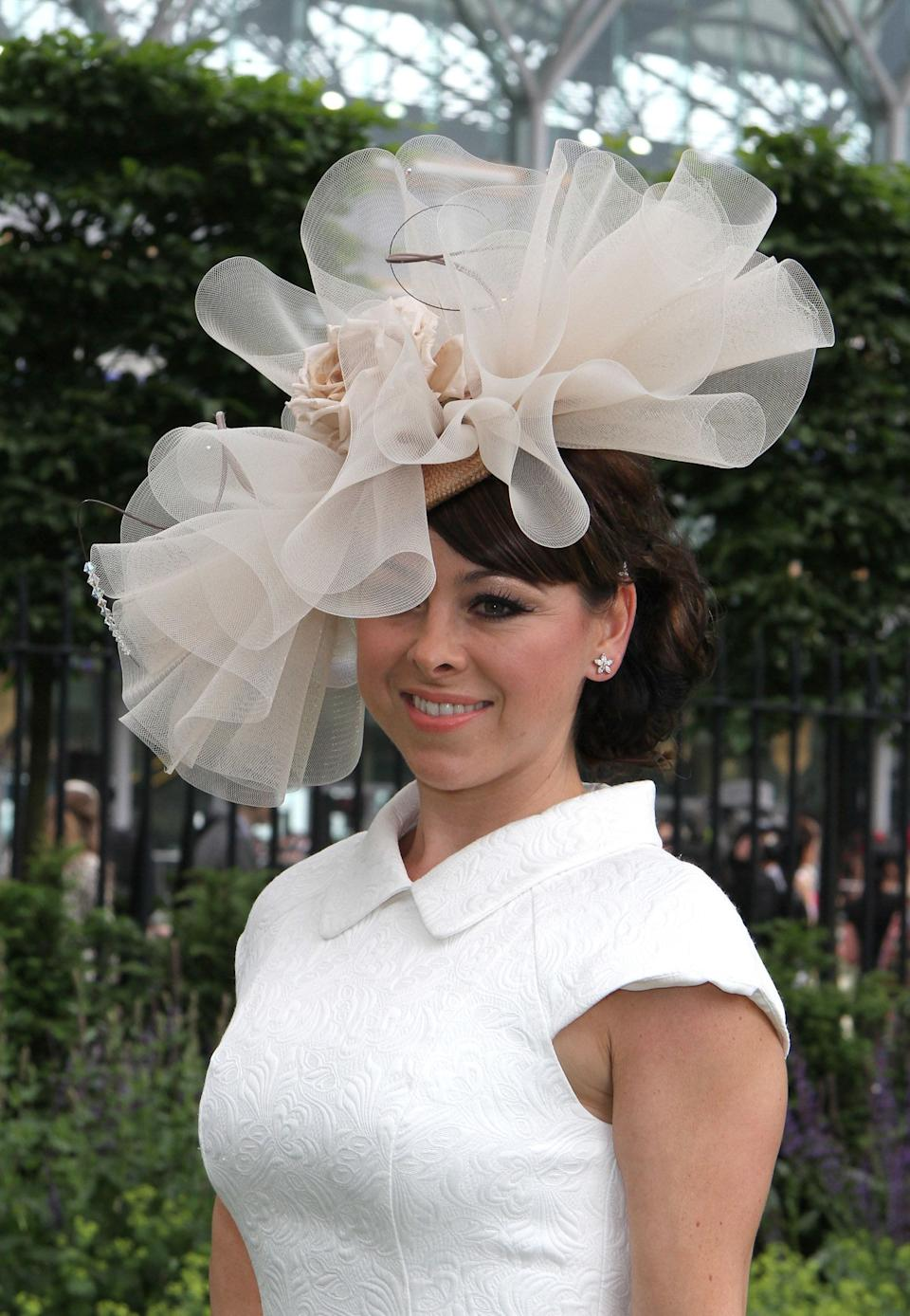 THAT FASCINATOR.<br /><br />In non-fascinator news, Lisa Scott-Lee was one of the stars to take place in the ill-fated Sky series CelebAir, later lacing up her ice skates to appear in Dancing On Ice.<br /><br />Her most notorious reality TV appearance, though, was in her own MTV series, Totally Scott-Lee' when she was filmed breaking down in tears when she learned her solo single had missed the top 20.<br /><br />Lisa also appeared as a housemate in a fictional, borderline-dystopian, series of Celebrity Big Brother, in the final episode of Ricky Gervais' comedy, Extras.