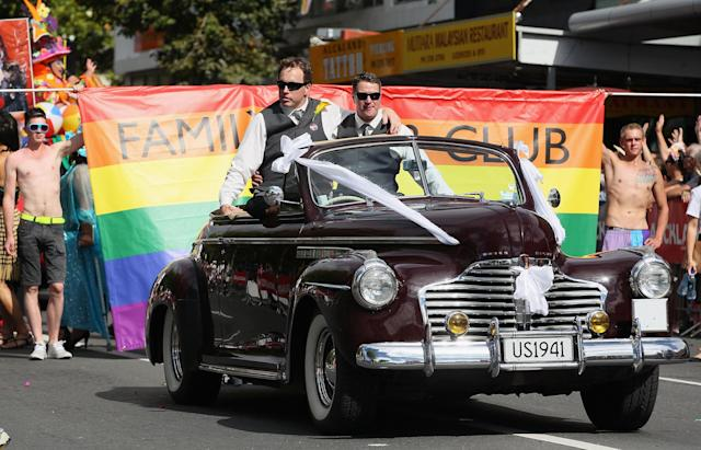 AUCKLAND, NEW ZEALAND - FEBRUARY 16: A float supporting gay marriage moves down Ponsonby Road during the Pride parade on February 16, 2013 in Auckland, New Zealand. The gay parade, celebrating lesbian, gay, bisexual and transgender (LGBT) culture has returned to Ponsonby Road after 10 years and organisers plan to put the parade on the tourism map, in the style of the Sydney Mardi Gras. (Photo by Sandra Mu/Getty Images)