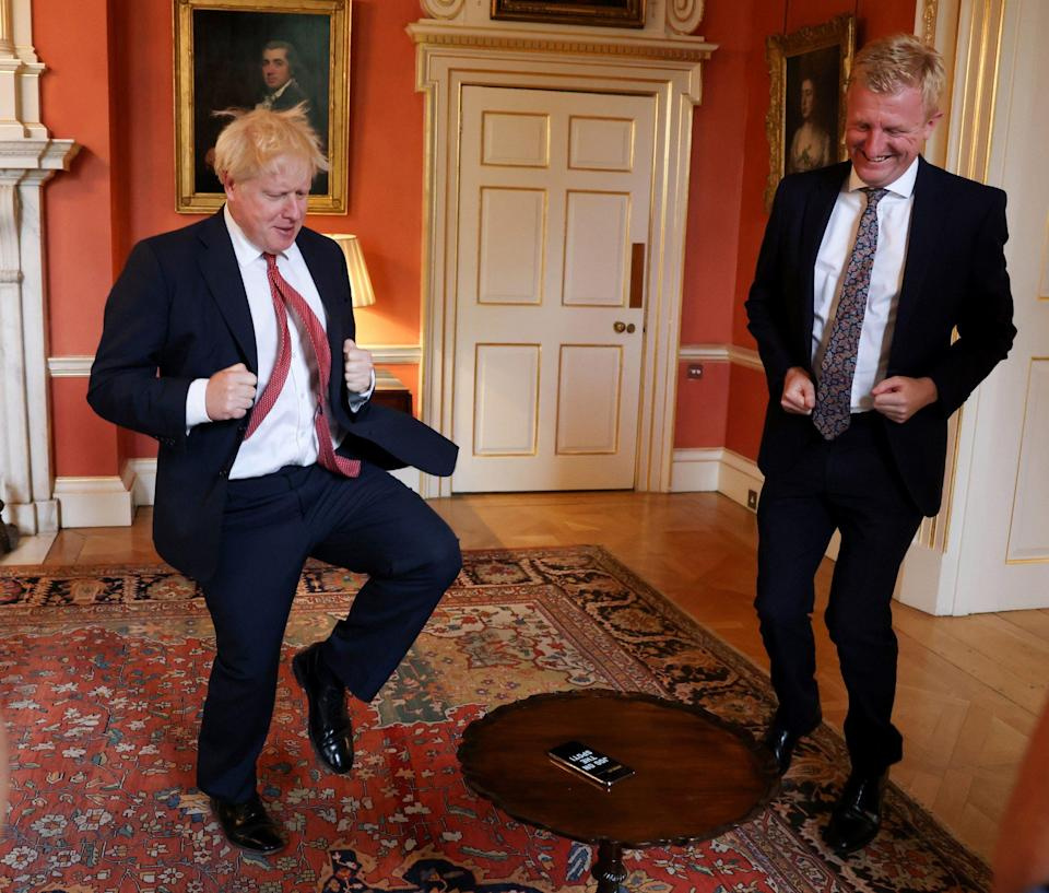 Boris Johnson and Oliver Dowden try out the Caper App at the London Tech Week Showcase - Andrew Parsons